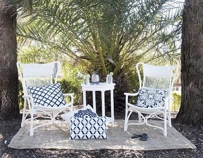 Joshua Rattan Sun Chair - White outdoors
