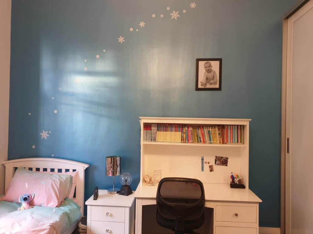 Old bedroom photo - dark blue wall with Frozen themed icicle wall stickers