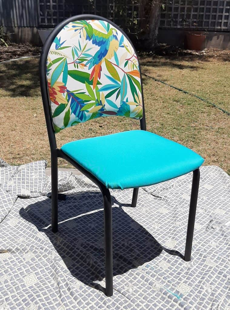 Finished chair upcycle. New fabric and painted black frame. Front view