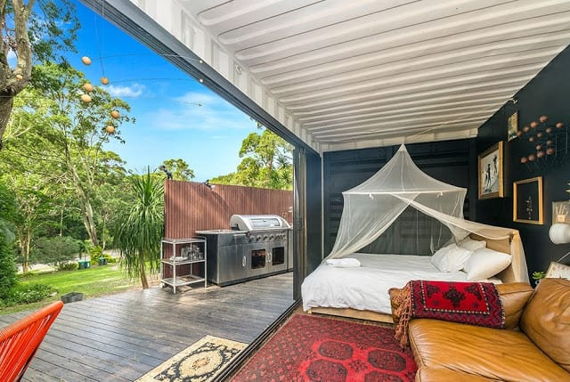 20ft Container House - living roomt elevation with living room opens on to stepped verandah