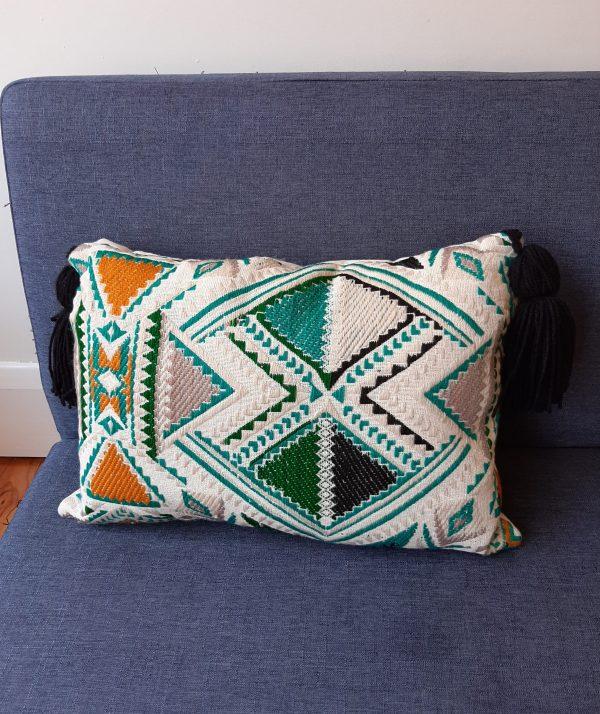 Plumbago aztec range pillows. One pillow on sofa.
