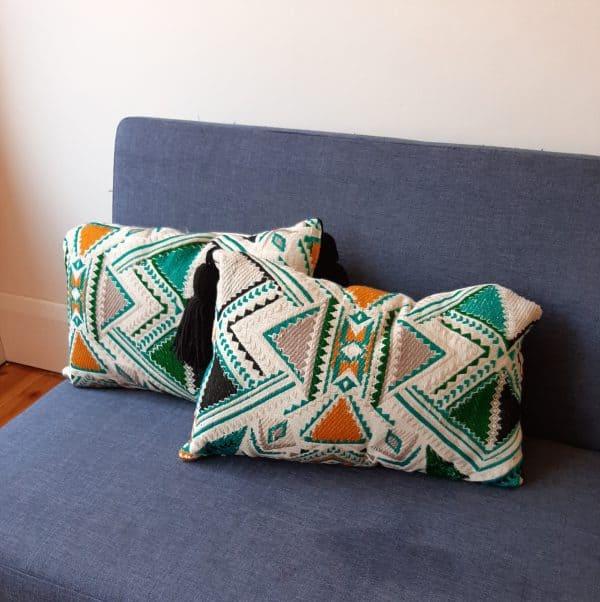 Plumbago aztec range pillows. Two pillows on sofa.