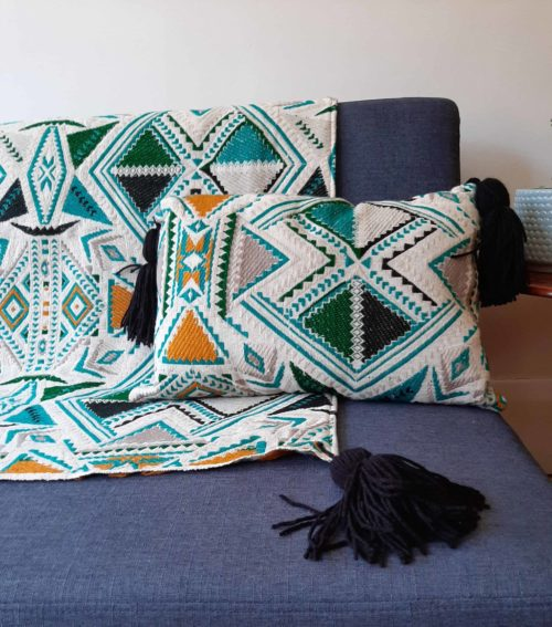Plumbago aztec range pillows. Set of two pillows and a throw on sofa.