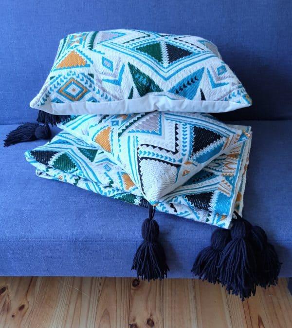 Plumbago aztec range pillows. Set of two pillows and throw on sofa.