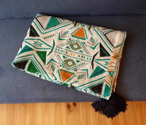 Plumbago aztec range pillows. Aztec throw folded on sofa.