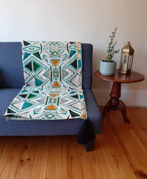Plumbago aztec range pillows. Throw on sofa.