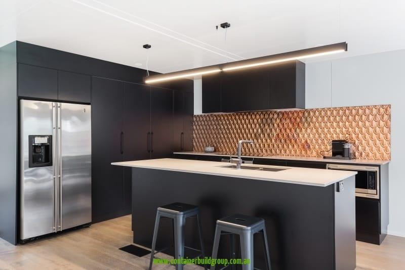 Cronulla - stylish black kitchen with copper back-splash