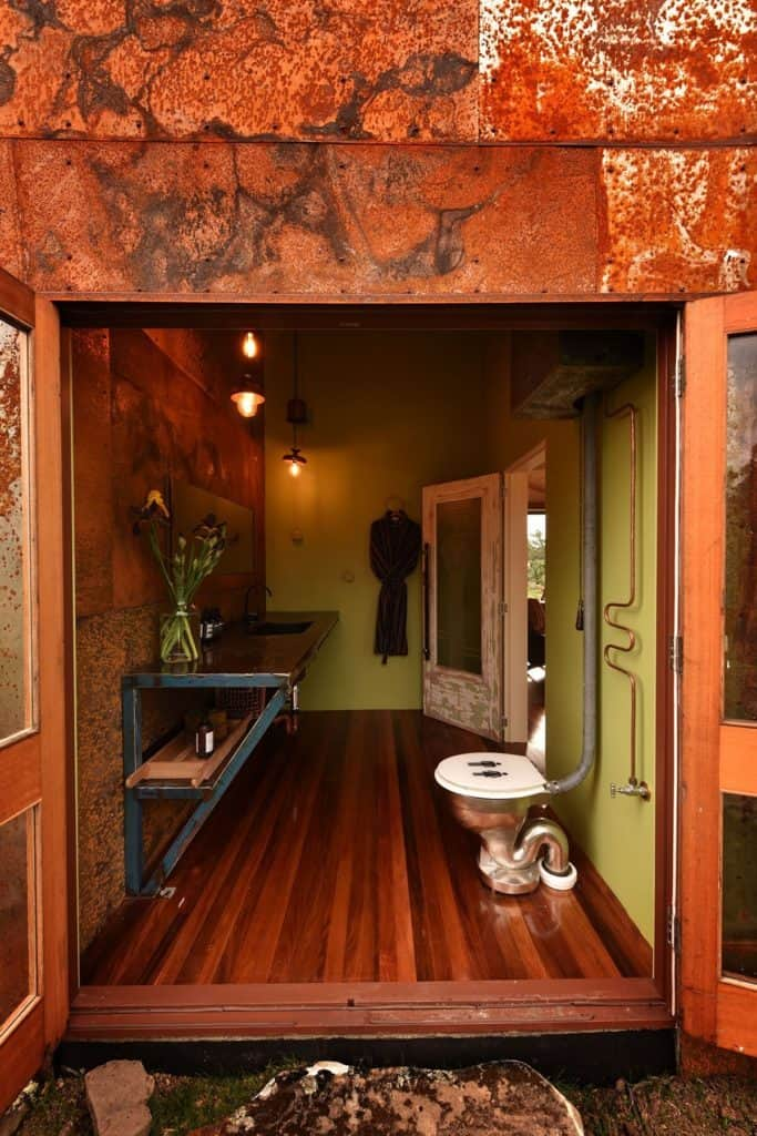 The Container - recycled shipping container luxurious bathroom with exposed pipework