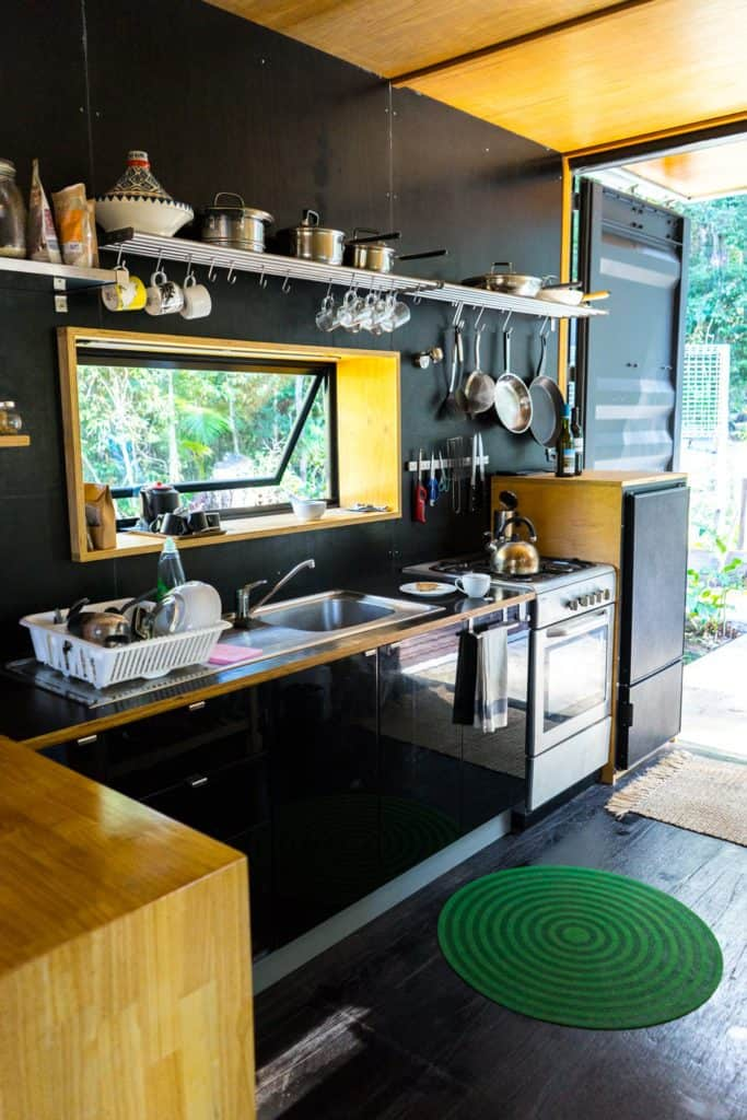 Off-grid container home compact kitchen