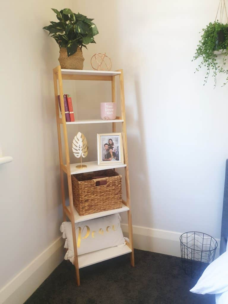 DIY bedroom makeover bookshelf with sophisticated accessories