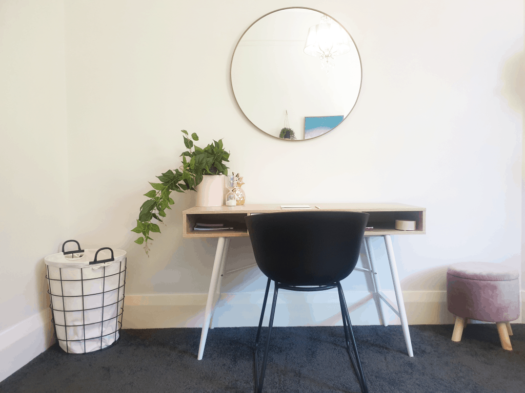 DIY Bedroom makeover - desk with plant and mirror above.