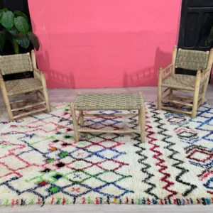 Amira Geometric Rug on floor with chairs and table on top