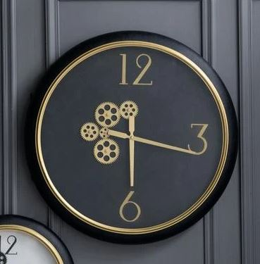 Black and gold wall clock with exposed mechanics