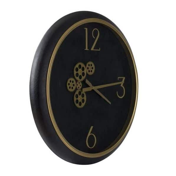 Black and gold wall clock with exposed mechanics side on view