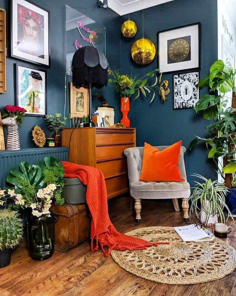 Eclectic decor style contrasting colours. ORange cushions and throw with teal walls.