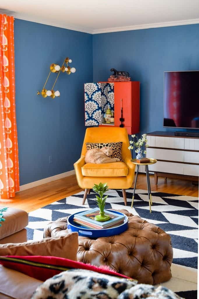Eclectic decor - mix pattern scales to avoid clashes. A living room with a variety of patterns at different scales.