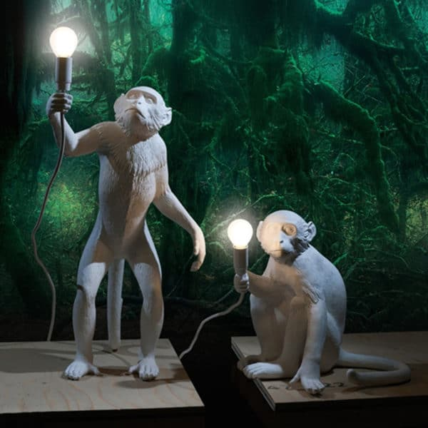 Monkey Resin Lamp standing and sitting. Bulb is placed in monkeys hands.