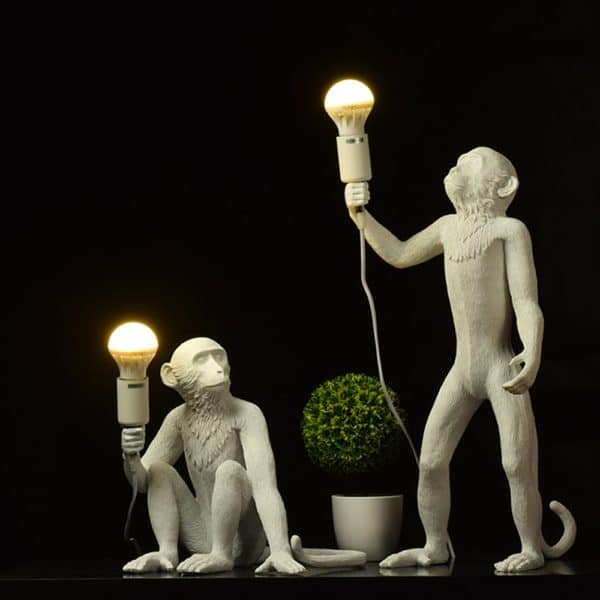 Monkey Lamps one sitting one standing in white
