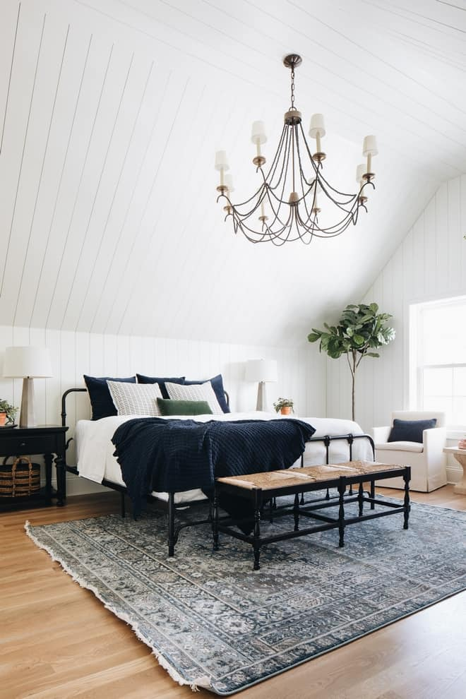 Modern Farmhouse Bedroom with metal bedframe, shiplap ceiling and walls, textured rug and throw
