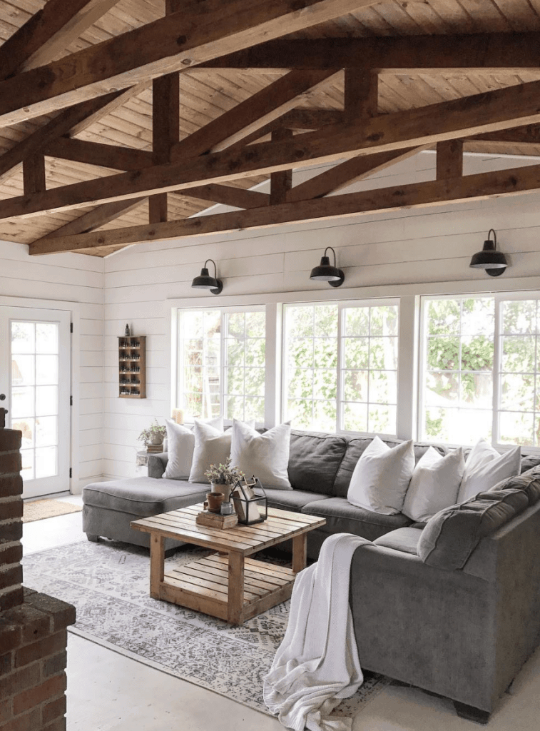 Modern Farmhouse living room with exposed timber roof trusses and shiplap walls