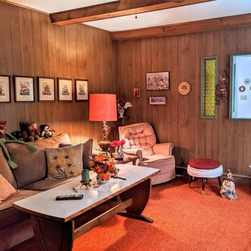 1970s living room with dark wood paneling on walls