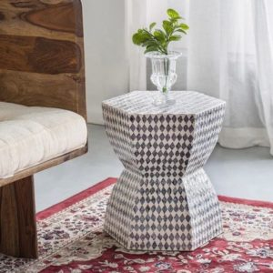 Handmade monochrome shell side table or stool in a living room
