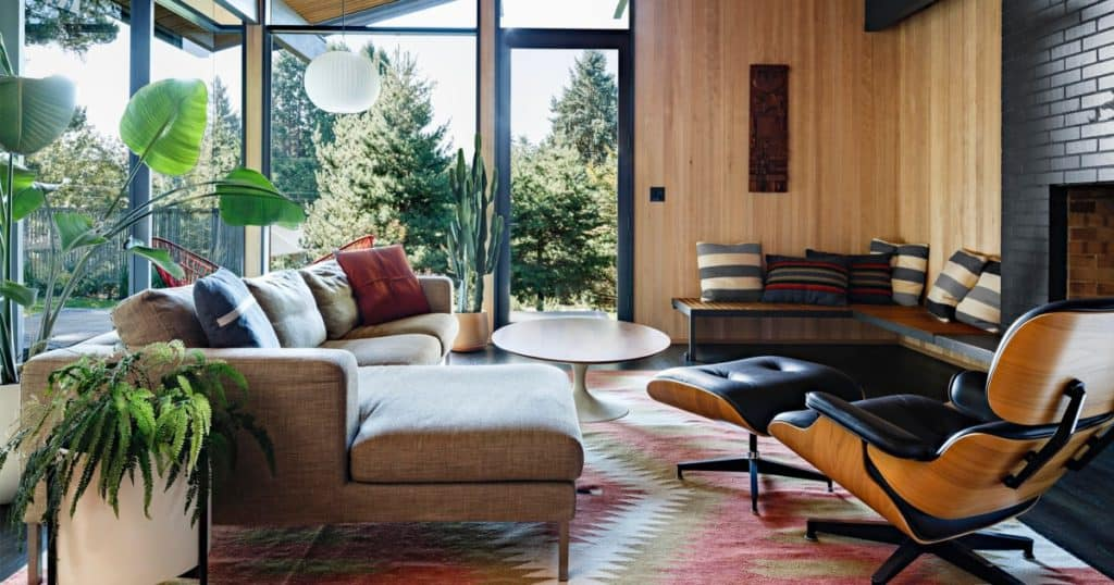 Living room with wood paneling. 70s revival interior design