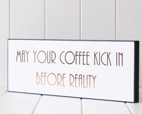May your coffee kick in before reality sign side view