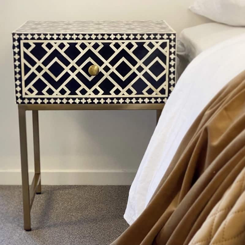 Ethically sourced bone inlay black side table in bedroom