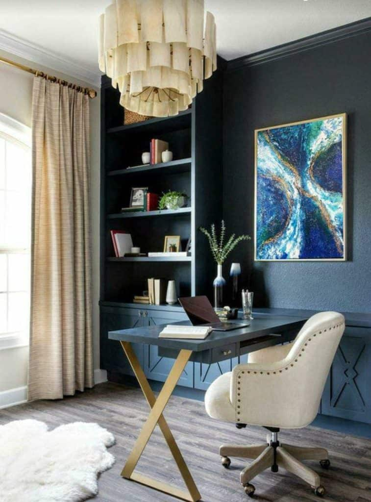 Statement home office featuring stylish storage, artwork and comfortable desk area