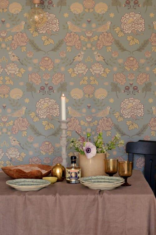 Sage green Majvillan wallpaper close up in dining room