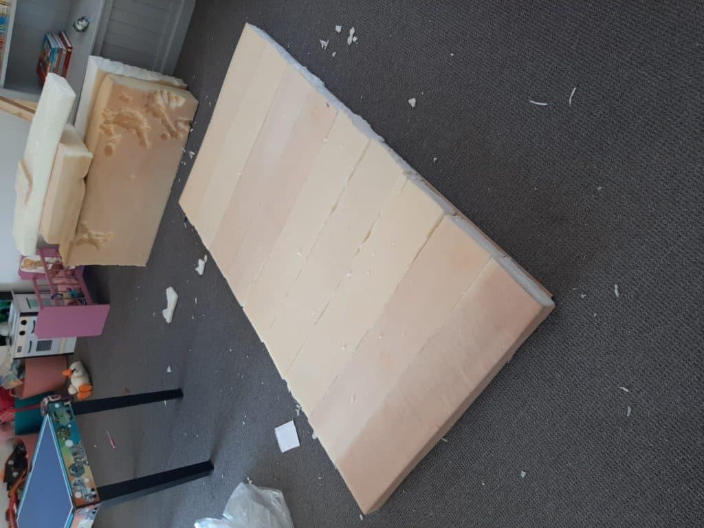 DIY Upholstered headboard - in progress. Foam mounted on MDF board.