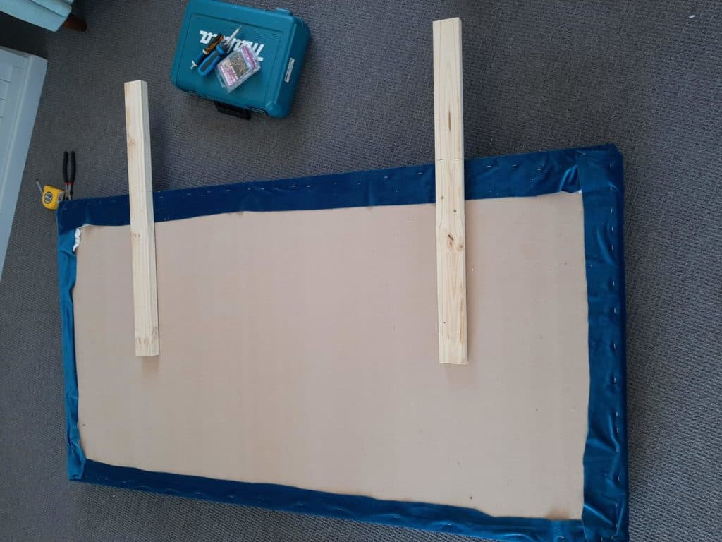 DIY upholstered headboard in progress. Attaching wooden supports.