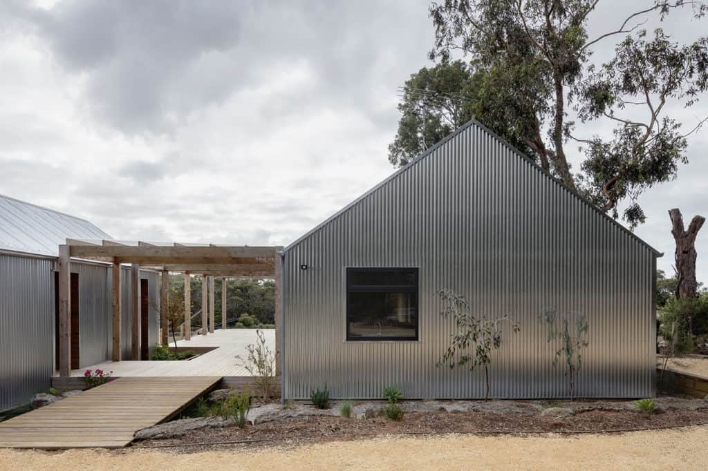Bellbrae shed house with galvanised metal cladding two buildings with linking courtyard