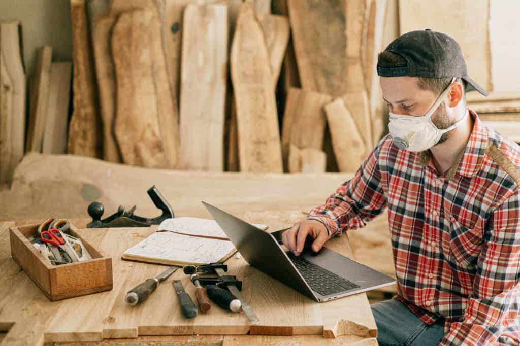 Photo of a man with his tools to create handmade timber products