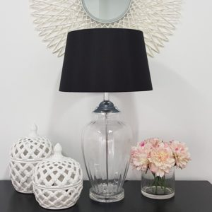 Lattice decorative lidded jar small and tall on side table with lamp