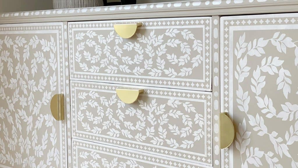 Vintage sideboard makeover. Bone inlay effect using stencils and paint. Close up of bone inlay effect detail.