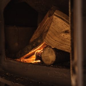 A photo of a wood heater fire burning